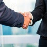 27413183-Close-up-of-business-people-shaking-hands-Stock-Photo